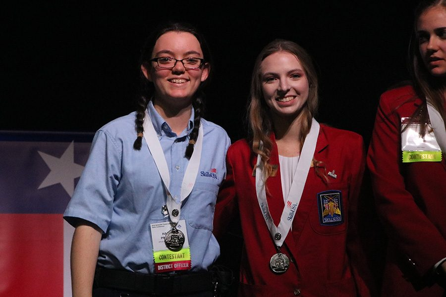 Stage presence \\ Seniors Haley Proctor and McKenna Steiner receive their silver medals, for building search the technical test.