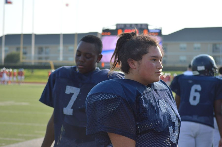 Girl power \\ Freshman Zoe Harbison is one of only two girls to ever play football at this school.