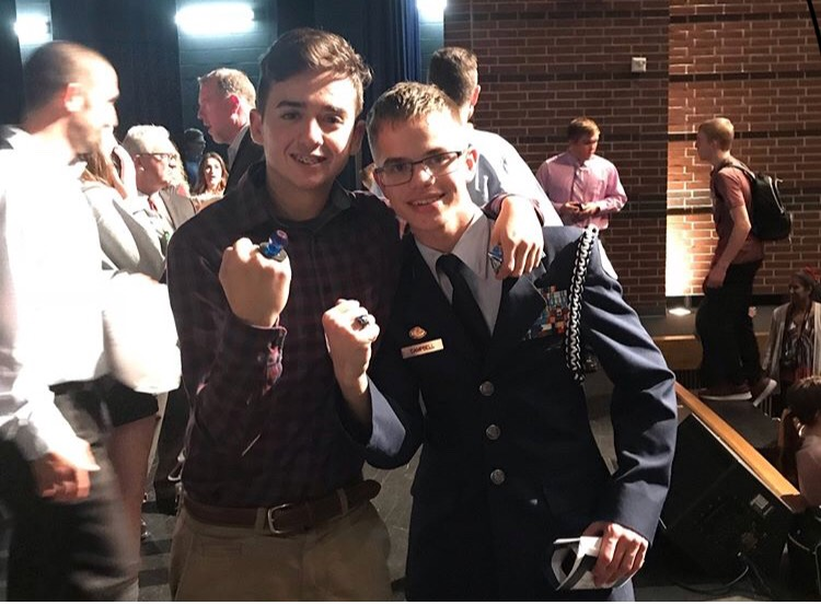 """Uncandy choice \\ Junior Cam Sipe shows off his ring pop after receiving it at the annual ring ceremony Nov. 29. Sipe decided to be presented with a ring pop to save money due to the high prices of class rings. """"It's better to buy a ring at 7/11 than to pay hundreds of dollars for one,"""" Sipe said."""