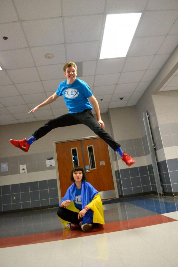 """Flying overseas // Flexing his high jump skills, junior Viktor Tereshchenko hops over sophomore Kate Panasyuk. Wearing the official t-shirt for their program, the foreign exchange students are from the Ukraine. """"Because of my program, I've gained a lot of leadership skills,"""" Tereshchenko said."""