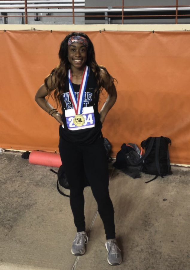 A pose of greatness // Smiling in her glory,  junior Destini Jeter places first in the UIL State meet in Austin for 300 Hurdles May 10.