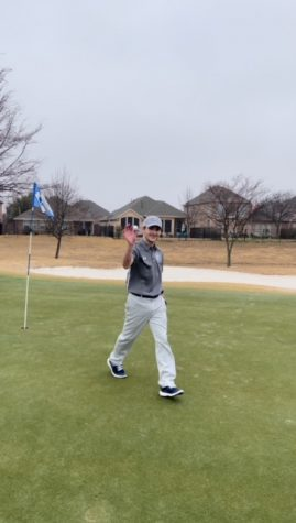 """One shot, one hole \\ Sophomore Carson Tittle grabs his hole-in-one ball from the hole to celebrate. He played with the junior varsity boys team at the RHS Big 4 competition at Waterview Golf Course Feb. 8. """"I have not gotten a hole in one at a competition before. In fact, this was my first hole in one,"""" Tittle said."""
