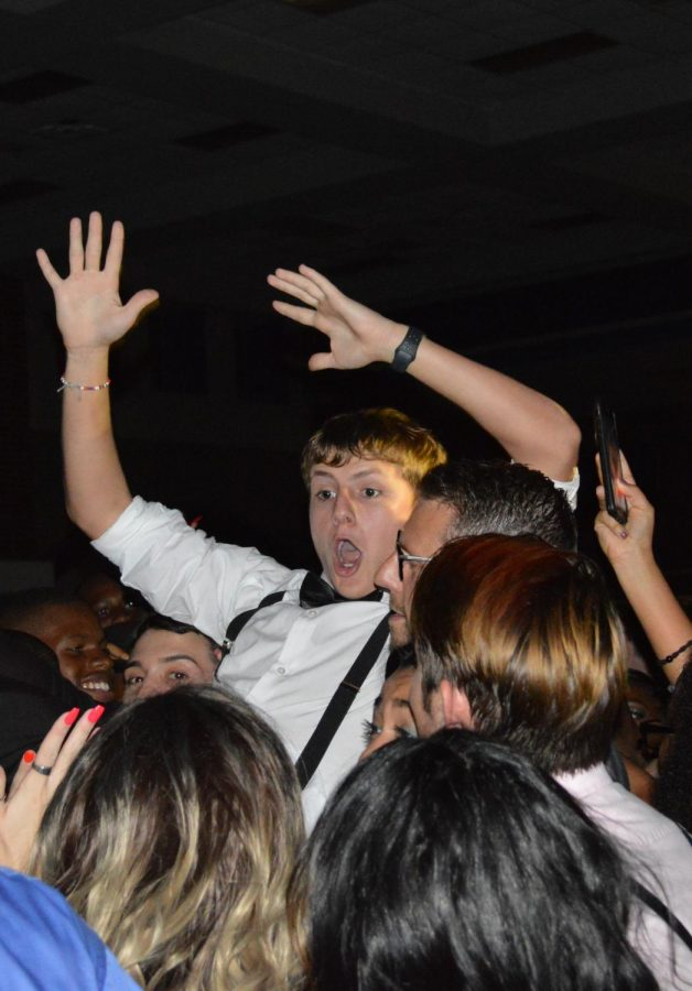 Hang ten \\ Crowd surfing at the homecoming dance, sophomore Maddox Fraley takes advantage of the sold out dance to float above the crowded mosh pit. The dance, themed Lights, Camera, Raiders was held in the cafeteria Oct. 19.