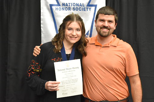 """Inducted with honor // Beaming from ear to ear senior Angela Lamarche takes a photo with Mr. Perry, her honored guest, as she is inducted into NHS last year. This year Lamarche is serving as NHS president and is excited for her duties. """"I love NHS so much,"""" Lamarche said. """"I fell in love with the values they stand for and amazing service they give when I was inducted last year and decided right then I wanted to be more a part of all the planning and behind the scenes that made NHS so prestigious."""""""