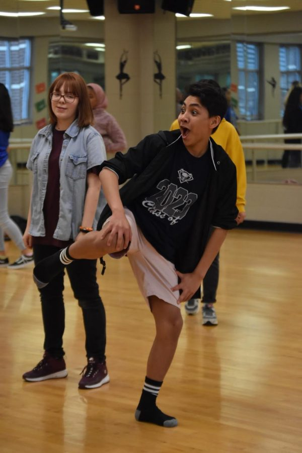 Clowning around \\ Warming up for practice, freshman Jhon Juntilla amuses his friends with his dancing. The hip-hop club, East Side Crew, free-styles to warm up before practicing their choreography.