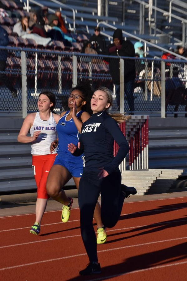 """One hundred percent  \ Finishing strong through her race, sophomore Emily Landry competes in the 100m dash at the Mike Williams invitational meet at Wylie High Feb.13. """"It was really cold while I was running, but finishing the race felt so good,"""" Landry said."""