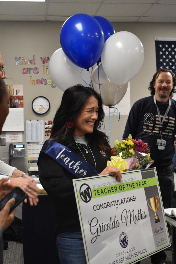 """Señora surprises \\ Taking in her moment of joy, Spanish teacher and winner of teacher of the year accepts her new title and gifts from the school board and staff. """"I am honored and overwhelmed with gratitude to be acknowledged as the Wylie East Teacher of the Year,"""" Mrs. Mathis said."""