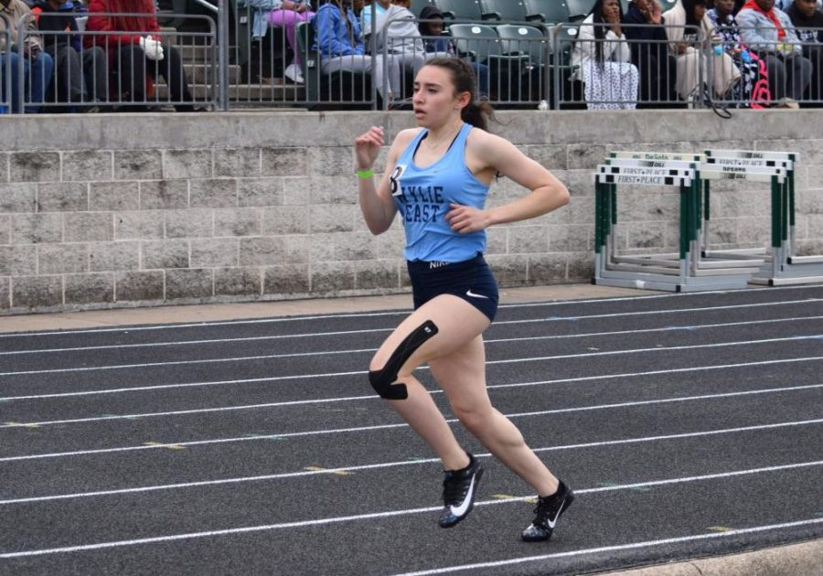 Time's up \\ Running at the Desoto track meet Feb. 22, senior Emily Flores competes in one of her final high school runs. The track season, and all spring sports, were cut short due to the coronavirus quarantine. Flores will continue running at Cowley College in the fall.