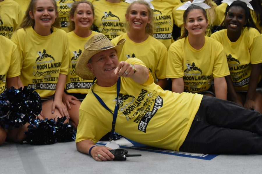 Yellow fever \ At the Gold Out Pep Rally in 2019, Mr. Williams poses with the students dressed in yellow to show support for victims of pediatric cancer.