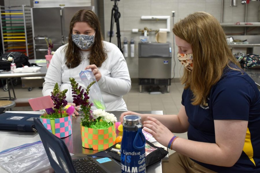 April flowers \\ Students in Ms. Taylor McAlisters first period floral design class spent the week making Easter arrangements using real flowers, plastic eggs and construction paper.