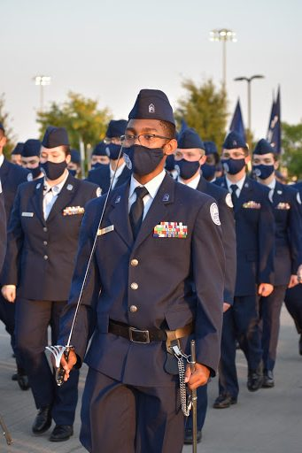 Head of the pack \\ Commanding the saber team C/1Lt, Toriono Garvin marches in the homecoming parade Oct 7. The Junior Reserve Officer Training Corps leads the parade every year.