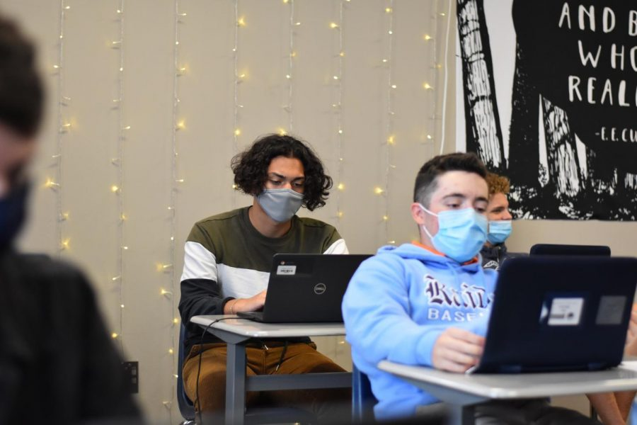 Back to Campus \\ Sophomore Patrick Alderete (back) revises his timed writing in Mrs. Lauren Stevensons fifth period English II Pre-AP class Sept. 22. Alderete was quarantined for two weeks because he was in close contact with a person who tested positive for Covid-19.