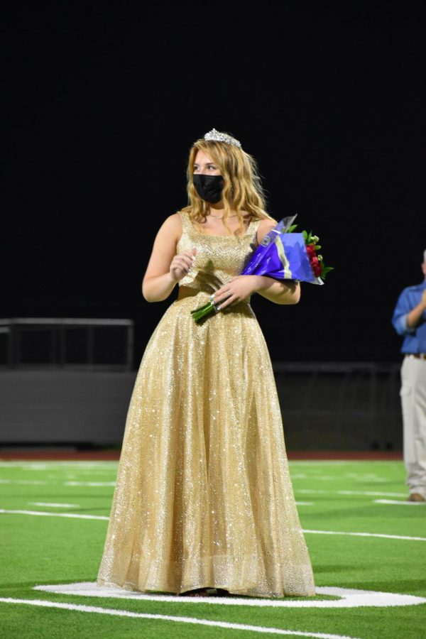 Crowning moment \\ Senior Jada Hahs is crowned as the senior homecoming princess Oct. 7 at the coronation ceremony following the homecoming parade. Senior Clayton Ensley was crowned senior prince. Due to an outbreak of positive COVID-19 cases among the football players, the homecoming football game was cancelled for the first time ever.