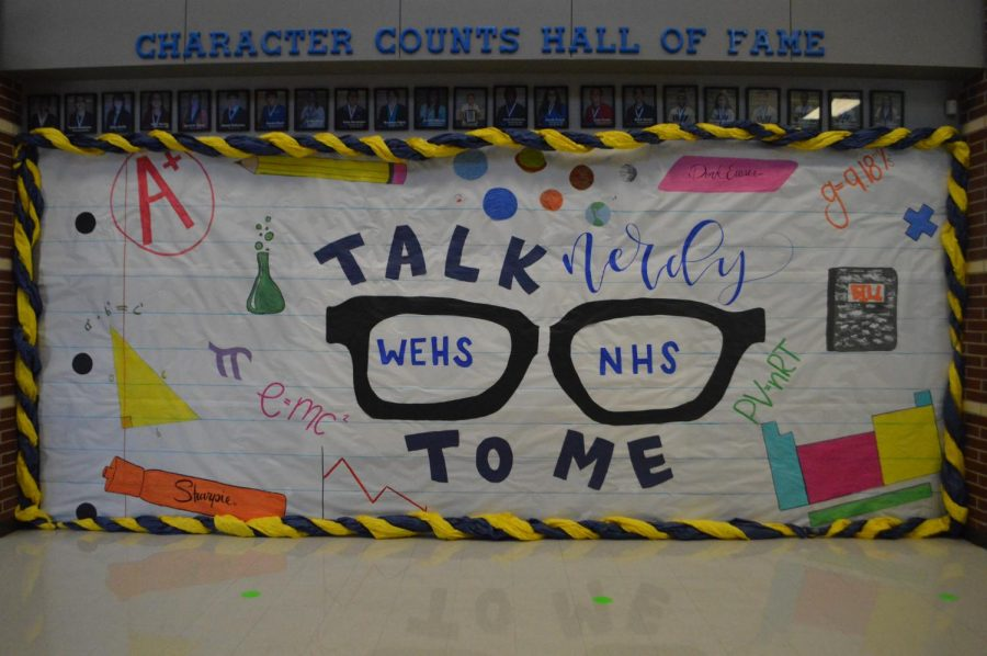 Off the wall \\ National Honor Society won second place in the hall decorating contest for Talk Nerdy to Me. First place went to SKILLS USA for their rendition of a football field filled with Raider pride.