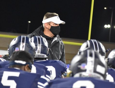 After the game \\ Coach Mike Dormady visits with his team after playing Highland Park Dec. 4. After five years of coaching at this school, Dormady resigned at the conclusion of the 2020 season.