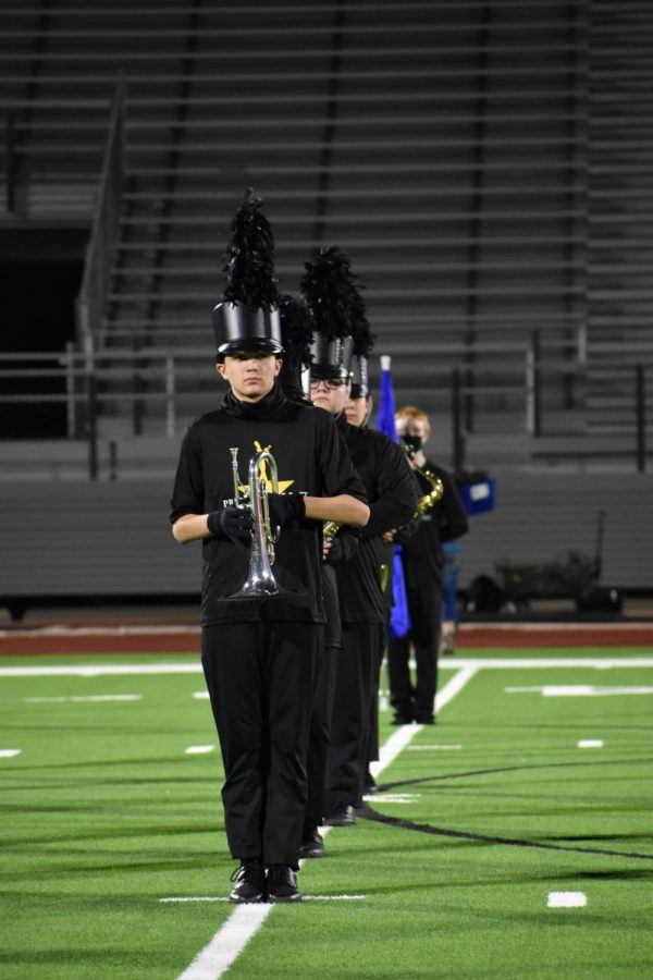 Main event \ Marching at the first-ever Fine Arts Half Time Show, senior Brayden Judge lines up to perform the halftime show: Hamilton. Due to football game cancellations, the marching band performed for the very first time Oct. 16.
