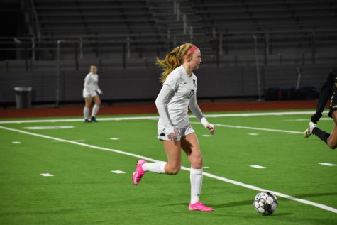 """On the ball \\ Freshman Bryn Geppert plays against Royse City Jan. 8. The freshman on varsity helped the team defeat the Bulldogs 4-0. """"I like the challenge of being on varsity and it's overall super fun,"""" Geppert said."""