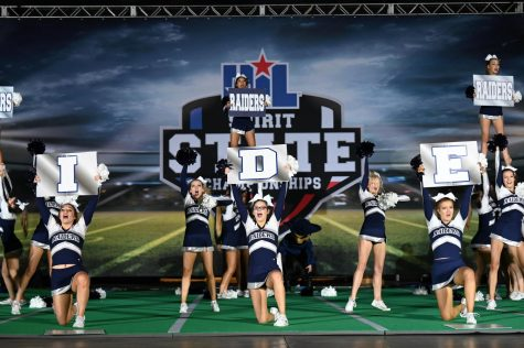 """Come out on top \\ The cheer team wins 12th at the State UIL competition, making school history with the highest scores ever received. """"Once we found out we made finals we went straight to practicing so we could hopefully win,"""" senior Kaitlyn Feece said."""