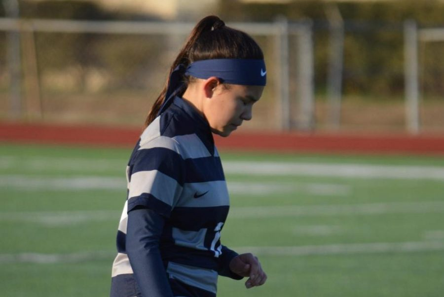 """Deep in thought \\ Preparing mentally for the next play, sophomore Mikayla Neveloff combines passes to help the JV soccer team win 2-1 against North Forney Jan 8. """"We work really hard in practices and it really pays off,"""" Neveloff said."""