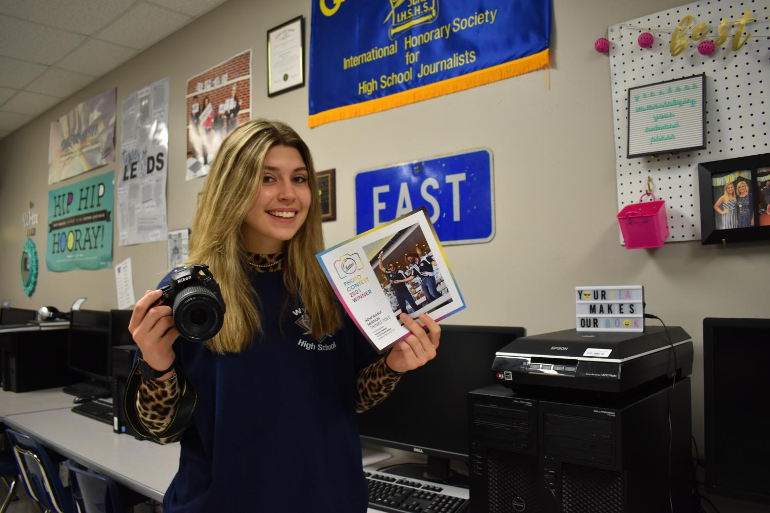 """Passion pay off \\ Sophomore Torrance Thedford poses with the photo she took that gained a national award in Jostens 2021 Photo Contest. """"I was so excited to win for something I love to do,"""" Thedford said."""