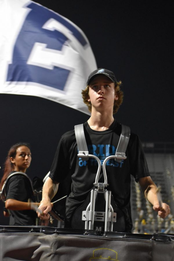 """On beat \\ Performing the Raider fight song, senior Daniel Cline leads the battery and band Aug. 26 during the last minutes of the varsity football game, defeating Mt. Pleasant High School 19-14. They play Irving Nimitz Sept. 3 for Homecoming. """"I'm excited for my last football season,"""" Cline said. """"Especially getting to lead the drumline for our show."""""""