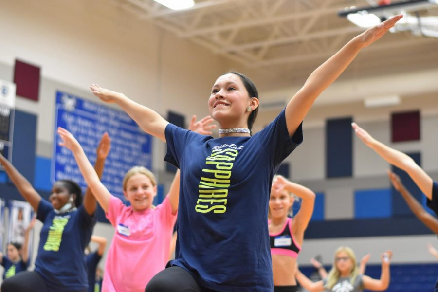 New member \\ After teaching her part of the dance, Sapphire Sergeant Maysen Harris, leads the routine run-through at the Jr. Jewels clinic Sept. 25. The clinic was open to all kids K-6th grade to learn a dance and a chance to perform with the Sapphires at a home game Oct. 8.