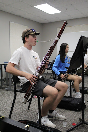 """Bassoon Tune \\ Rehearsing the Bassoon trio for the Wylie East's marching band show, """"Efflorescence"""" seniors Austin McKinnon and Aileen Khu play alongside the help of senior Logan Staub during the summer to produce an impactful third movement for the 2021 season."""