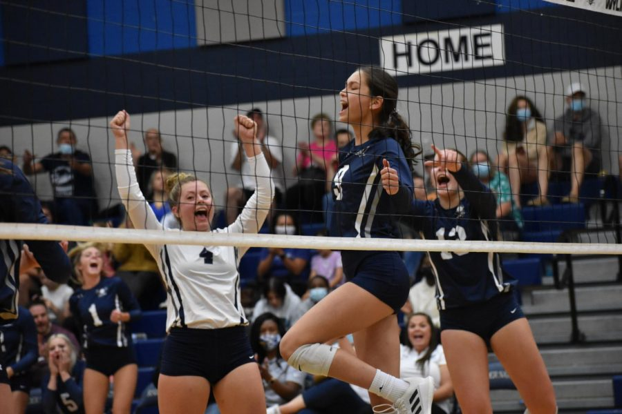 On+cloud+9+%5C%5C+Playing+in+the+varsity+volleyball+game%2C+freshman+Amy+Hernandez+and+the+team+celebrate+her+kill+against+JJ+Pearce+Aug.+17.+%E2%80%9CI+like+playing+with+the+girls+on+varsity.+That%E2%80%99s+where+I+feel+the+best+fit%2C%E2%80%9D+Hernandez+said.+Varsity+won+3-0.+