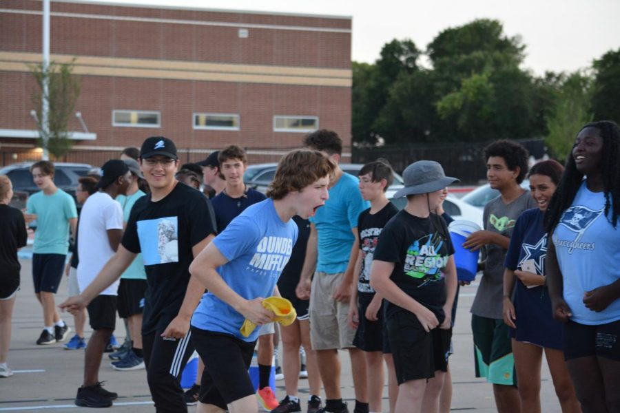 """Lets gooo! \\ Senior Daniel Cline motivates his team to win the band Splash Olympics. The band held the first ever Splash Olympics to celebrate the end of band camp Aug. 20. """"Getting back into the swing of things after COVID was a real challenge in band camp,"""" Cline said."""