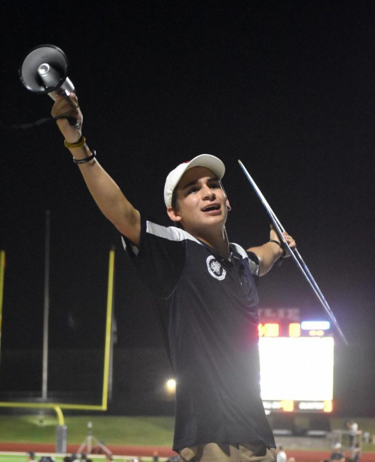 Spirit leader \\ Senior Everett Vasquez leads the student section at the varsity football game against Mt. Pleasant Aug. 26. Be at the football games and pep rallies, Vasquez said. Get involved in school events, be loud and excited at the school events you attend. Don't be embarrassed to put yourself out there.