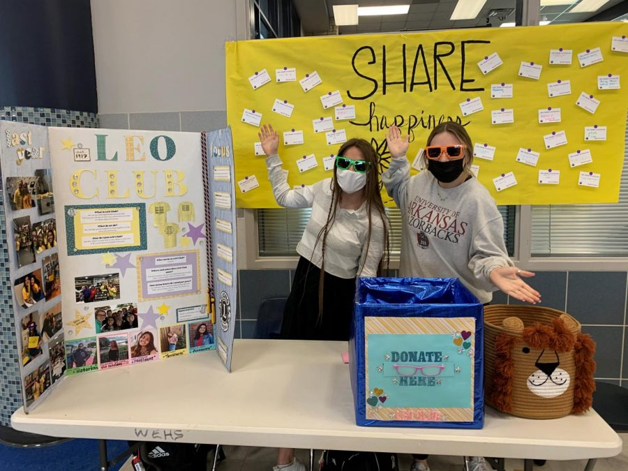 """Juniors Avery Farris and Ella Waters volunteer during lunch for the eyeglass drive hosted by the Leo Club. """"I love being a part of Leo Club because I love serving and volunteering to help people in need, Farris said."""
