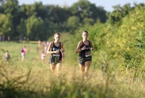 """Running mates \\ Sisters Faith Seddig and Evy Seddigboth run cross country. """"It's really fun to have a partner to do everything with, but also stressful because you want to beat her,"""" Evy said."""