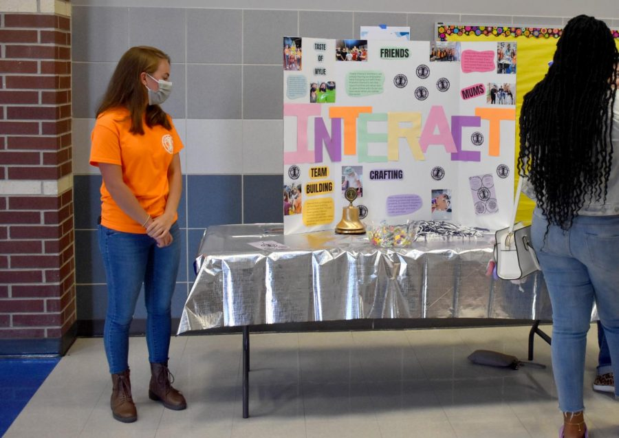 Interacting with students \\ During East Side Rally, clubs showcased their programs to students as they picked up their schedules and toured the school. Bailey Causey represents the Interact Club.