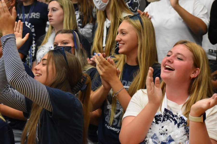 Round of Applause \\ Cheering and applauding in the stands, juniors rock their class colors during the first school pep rally, Sep. 3.