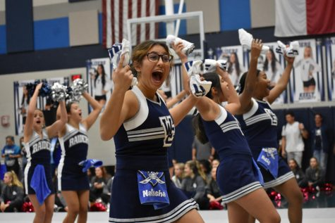 """Cheer up \\ Throwing t-shirts at the pep rally, sophomore Natasha Kunze hypes up the students with the other cheerleaders. """"I love the interaction between students and teachers. I love cheering with my team and doing fun, cool skills,"""" Kunze said. The last home game and pep rally of the year was Oct. 21."""